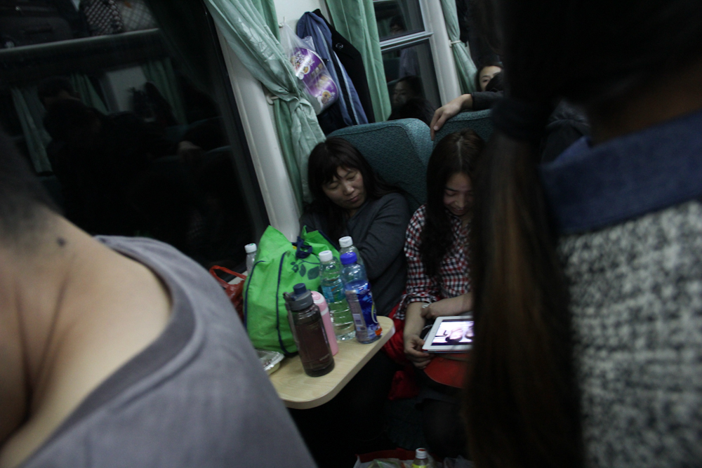 Zhang Junmei sleeping during the 24-hour journey from Shenzhen to her home village in Henan province, February 2013.