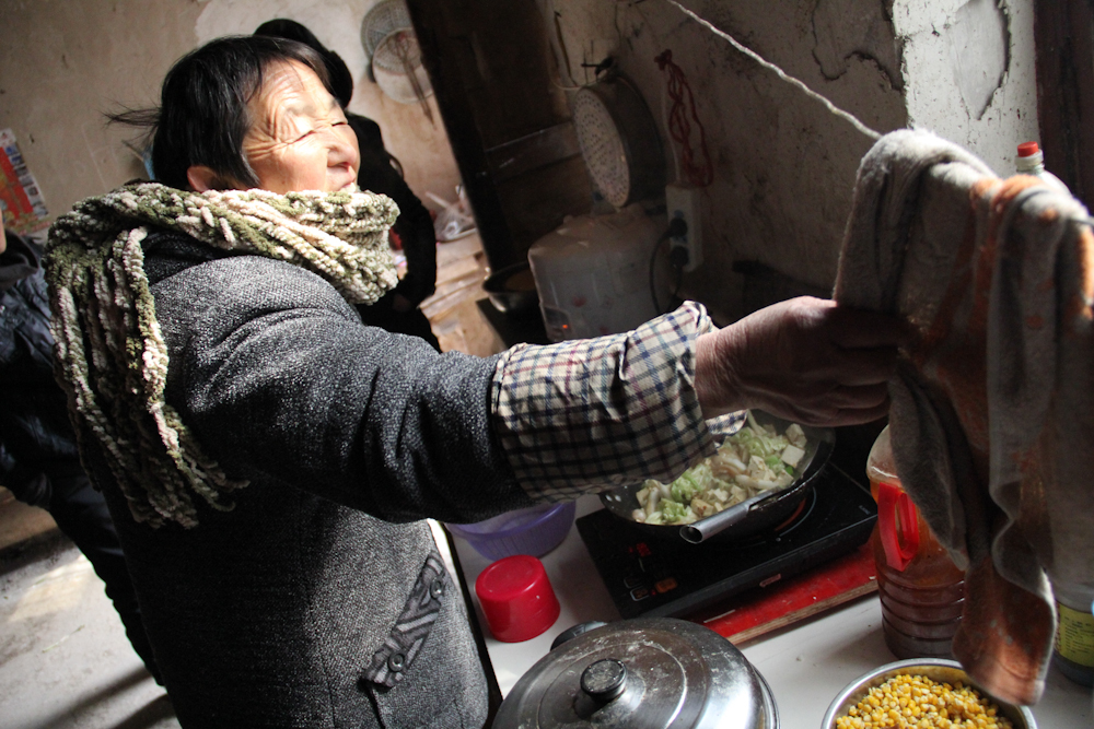 The grandparents, who are raising Yuan and Zhang's son Yuan Jinkang while the parents are away working in a factory in southern China, are making dumplings for the Lunar New Year celebrations, February 2013.
