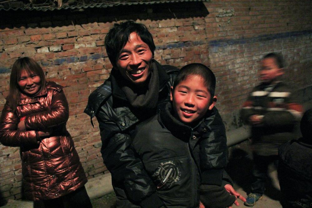 Yuan Zhitong and his son Yuan Jinkang, 10, celebrating the lunar new year, February 2013.