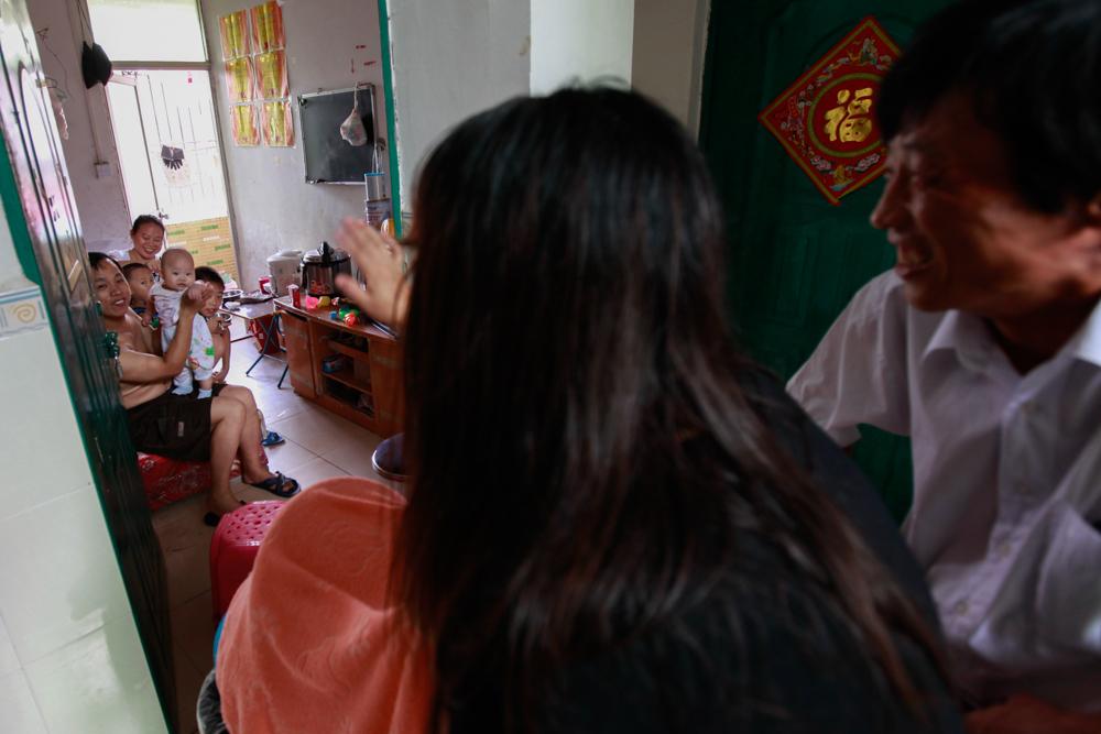 Yuan Zhitong and Zhang Junmei back in their Shenzhen factory dorm room, August 2013.