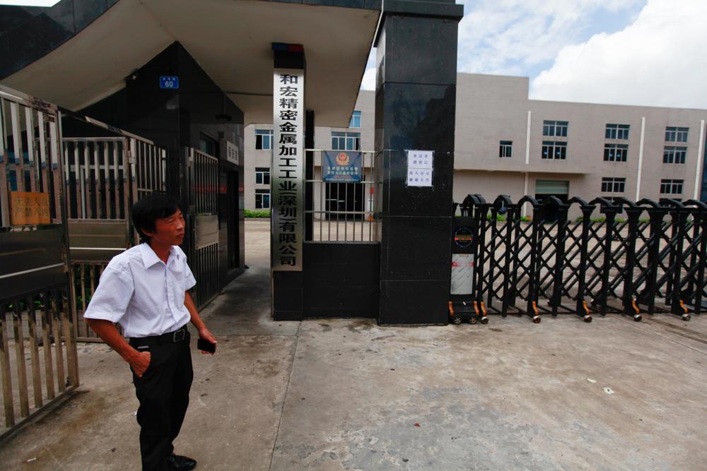 Yuan Zhitong outside his factory in Shenzhen, August 2013.