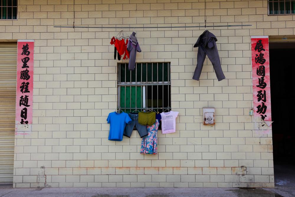 Outside Yuan Zhitong and Zhang Junmei's dorm building in Shenzhen, August 2013.