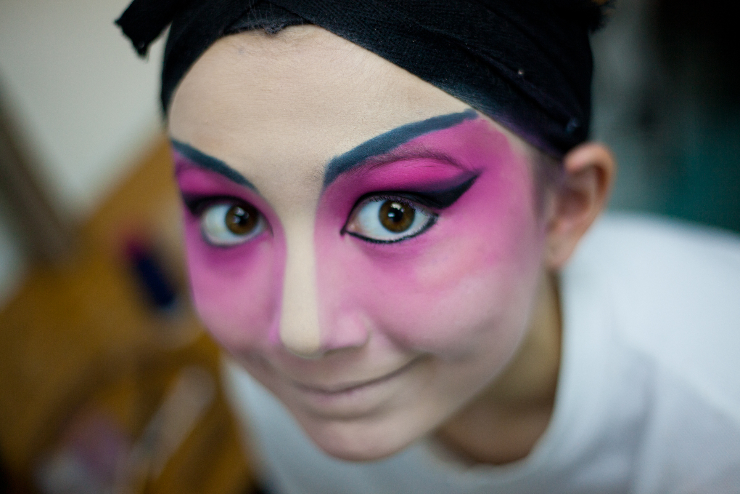 Chloe Ng- Brossard, 10, shows her makeup before a performance of Cantonese Opera in Hong Kong, April 2012.