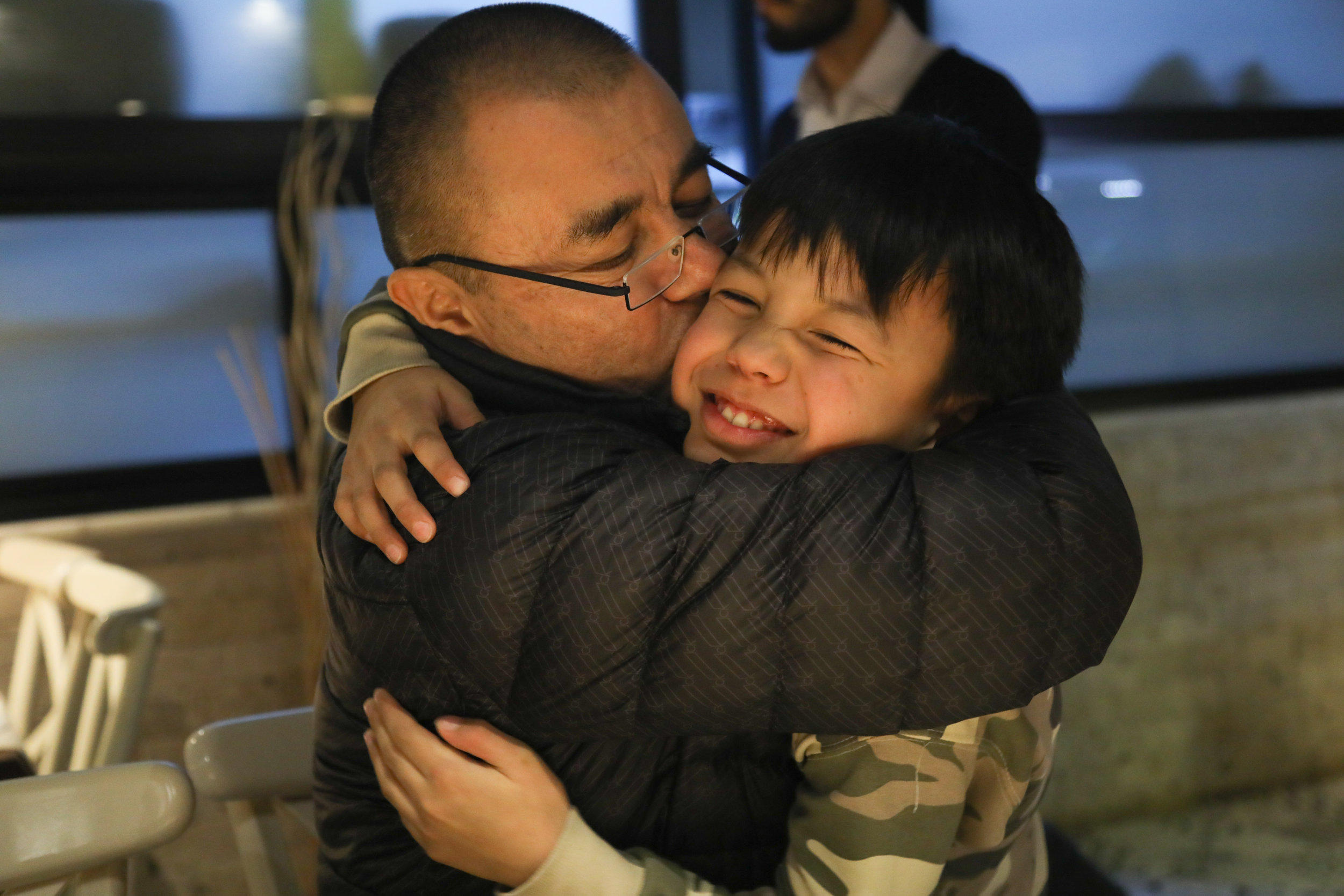 Kerem Mamut embraces his son Babur, whom he did not see during his three-month detention