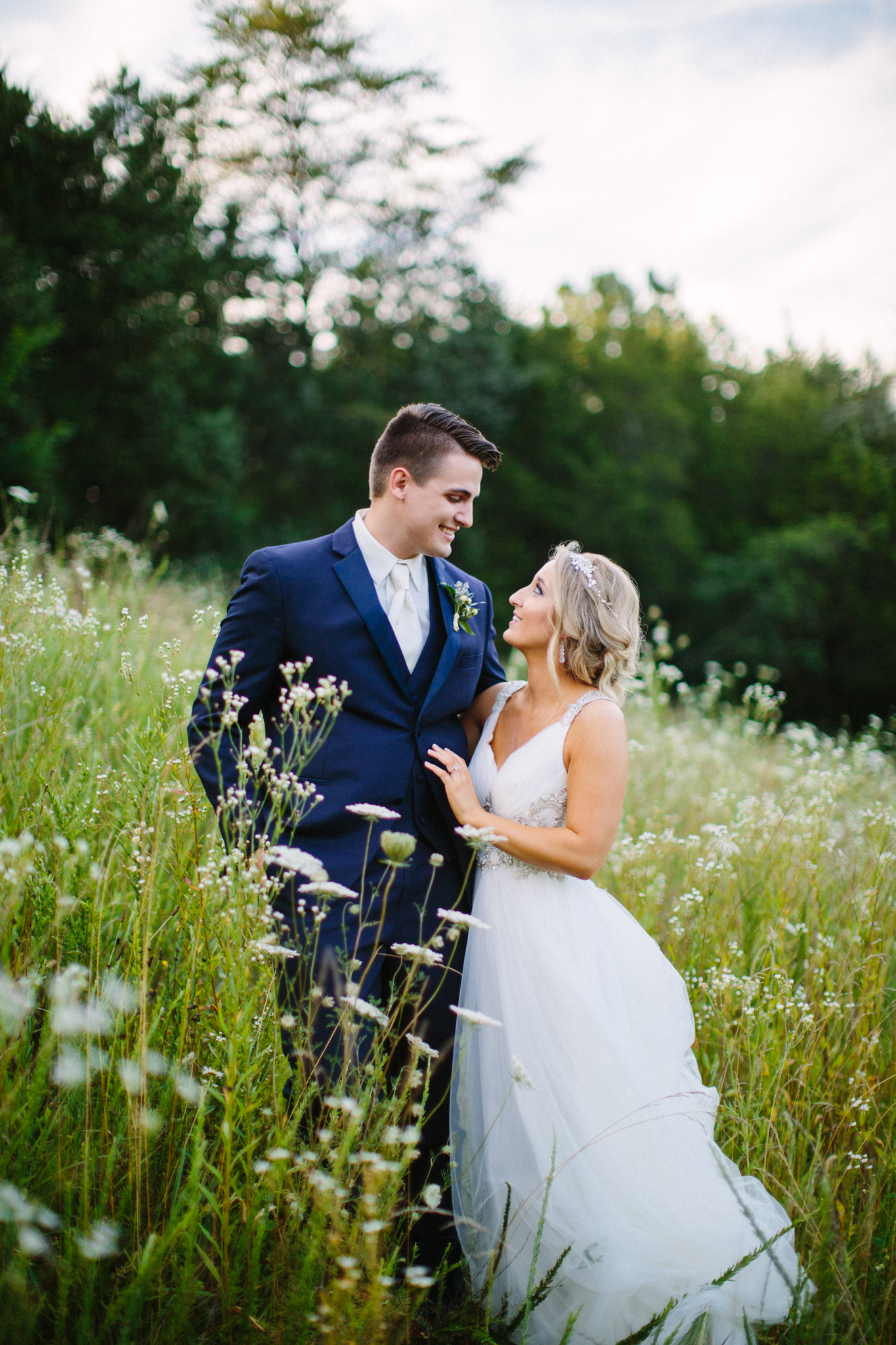"""Sarah is the absolute best of the best! I find myself recommending her to every newly engaged couple that I know! My husband and I were so pleased with our wedding photos; everytime I look through them, I decide on a new favorite! Sarah did a fantastic job at capturing our personalities, love for each other, and all the important details of our wedding day. She is affordable, a pleasure to work with, and produces a product that will definitely exceed your expectations!""  KATIE+JEREMY"