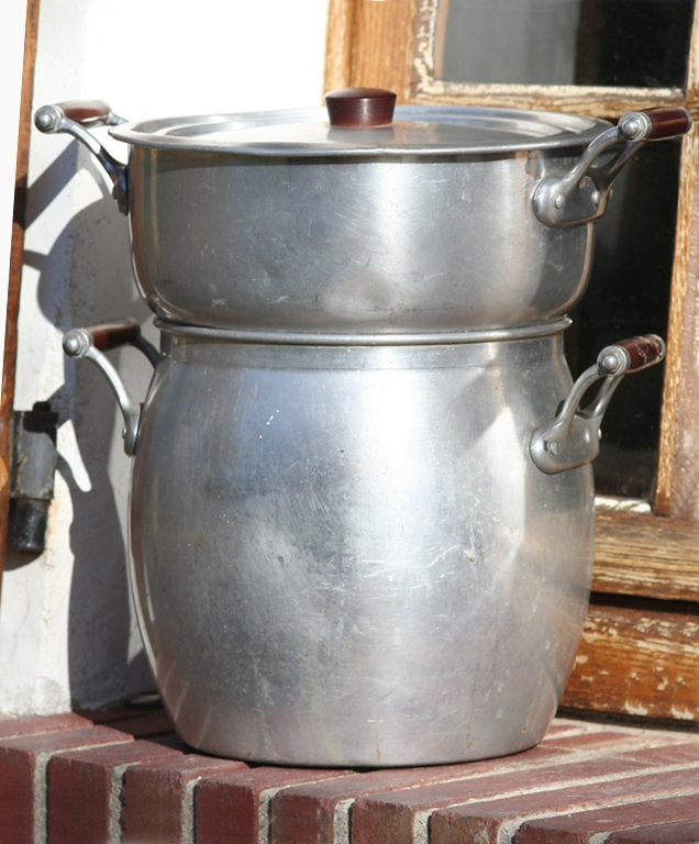 The couscoussier is a traditional two-pot steamer to cook couscous. The bottom pot can also be used for cooking the stew.