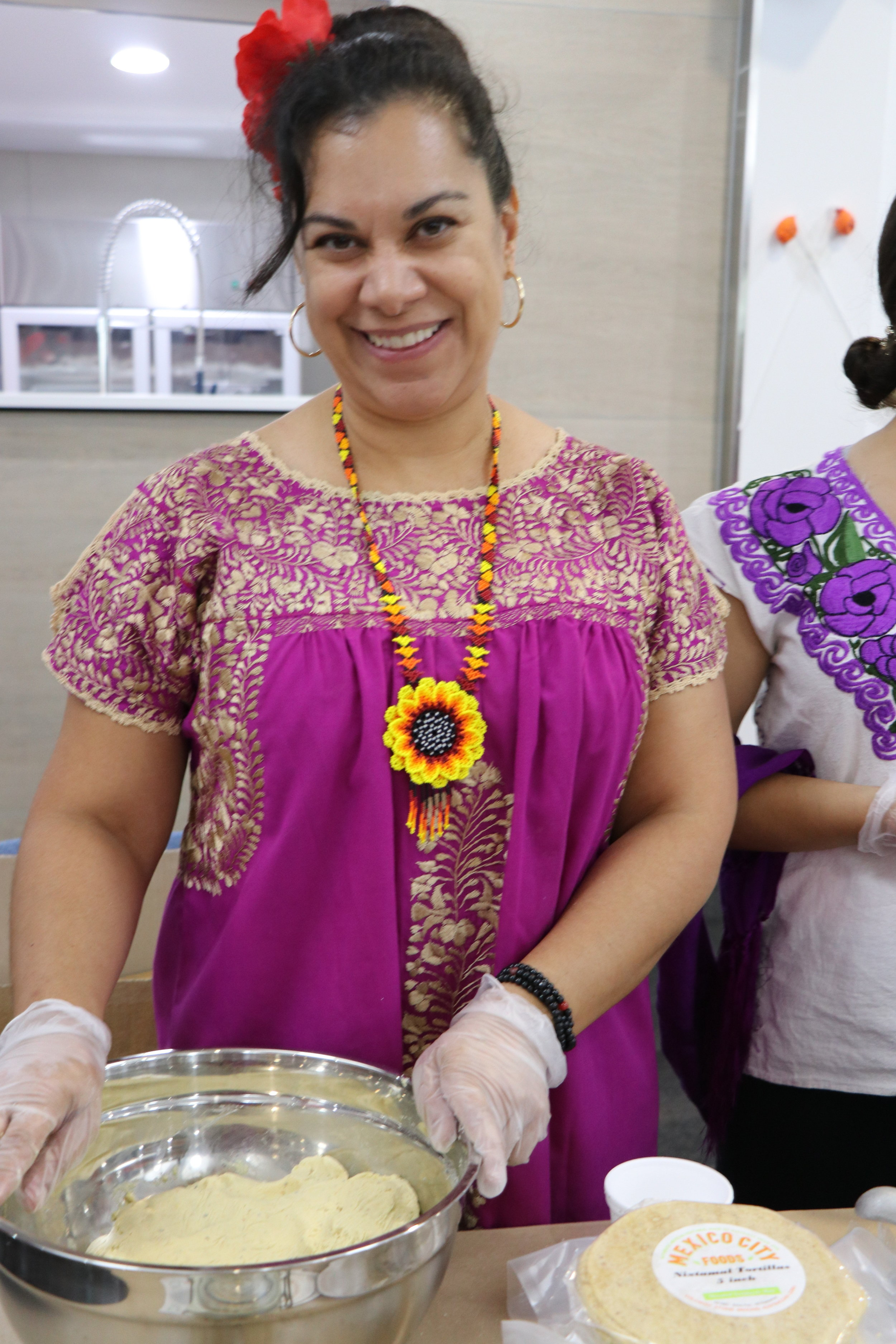 Diana from Mexico City Foods making Tortillas at Breaking Bread. Image Courtesy of Naomi Shore