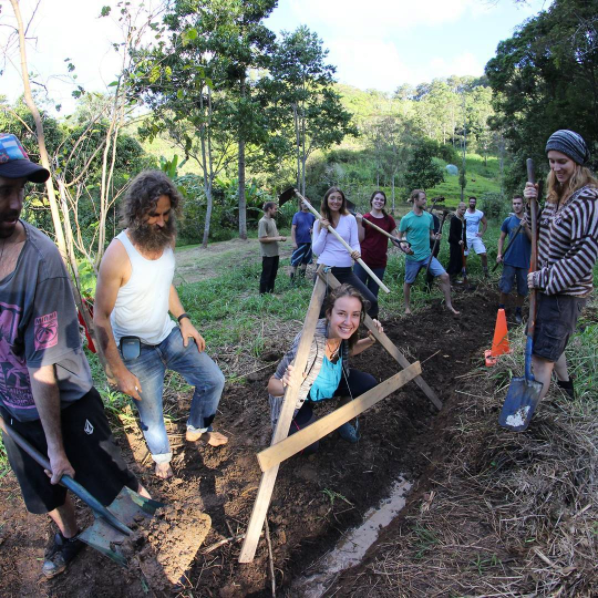 Ian Trew (Second from L) facilitates a permaculture design course at Noosa Forest Retreat    Source Noosa Forest Retreat.png