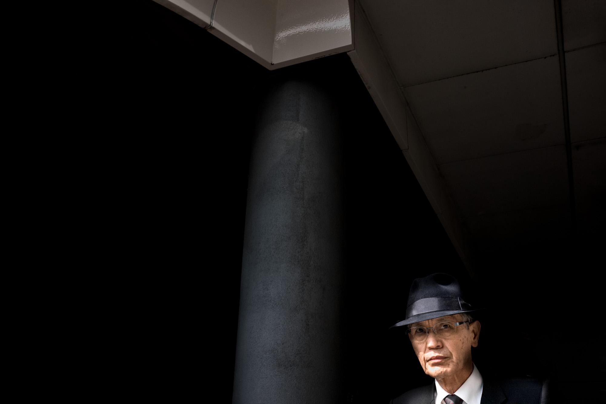 tokyo-salaryman-emerging-from-the-shadows-2000.jpg