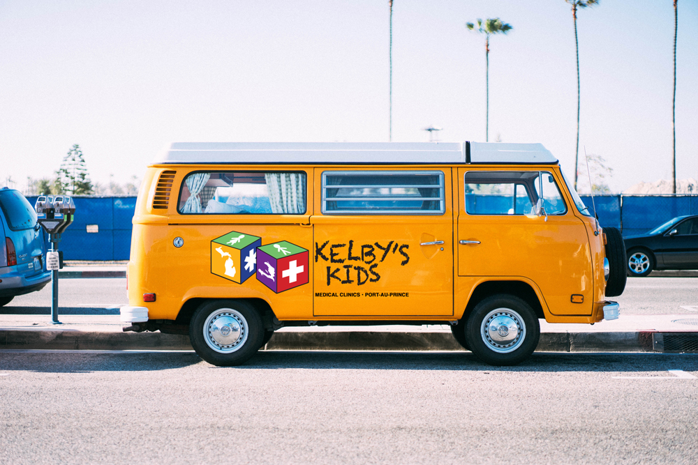 What kind of vehicle should Kelby Kid's drive around the bumpy roads of Port-Au-Prince? A VW Westy?