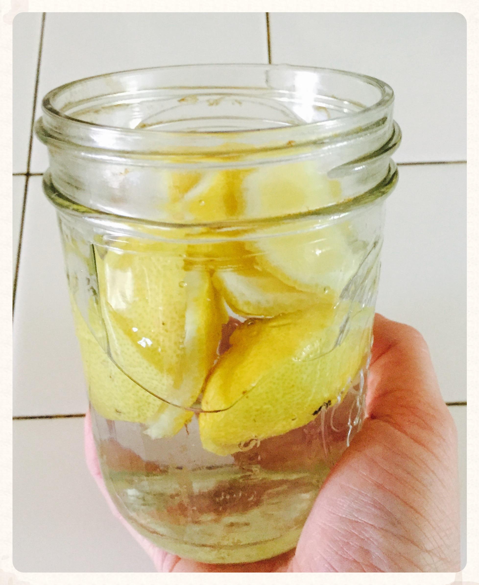 Infusing vinegar with lemon rinds.