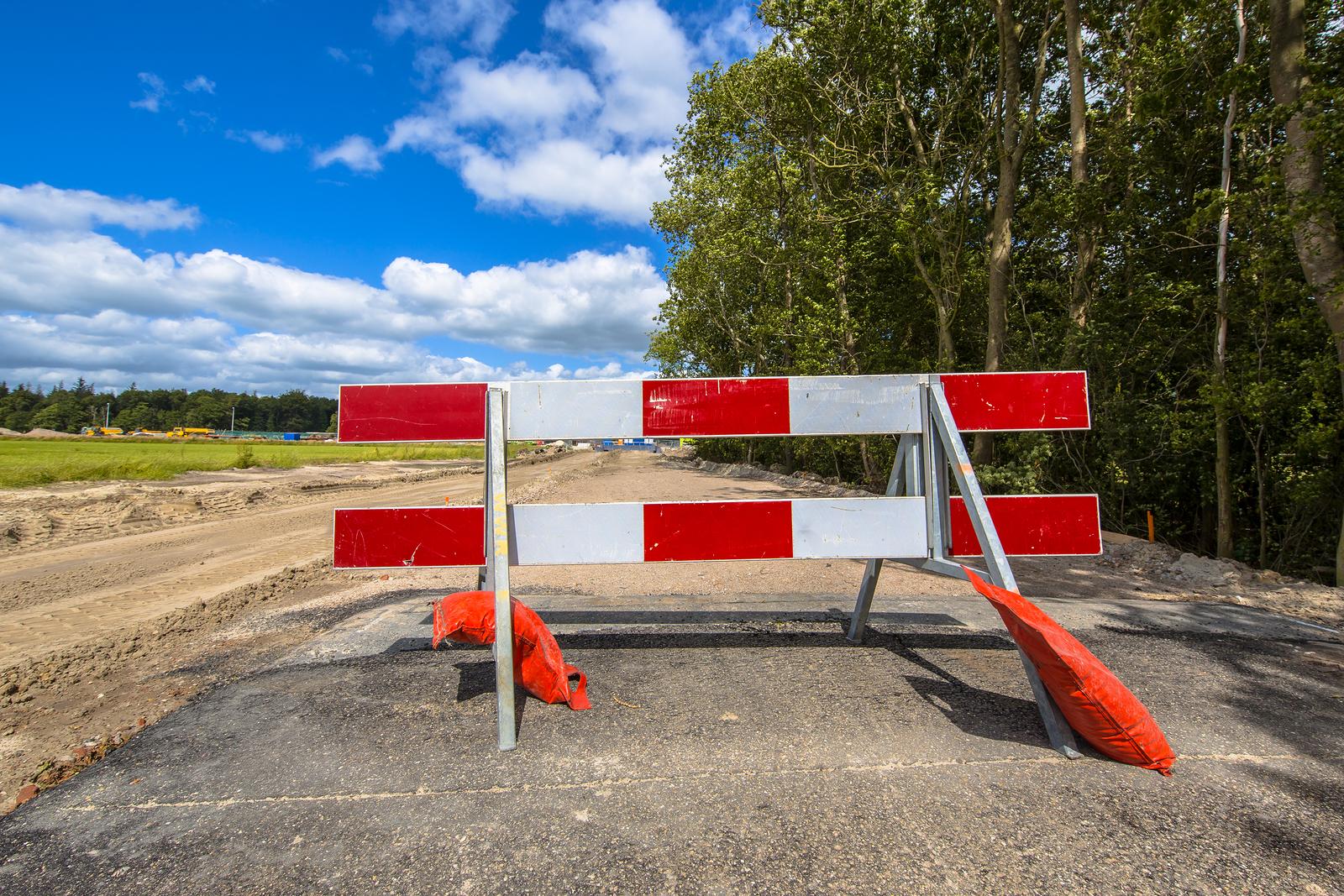 bigstock-Red-And-White-Roadblock-208901374.jpg