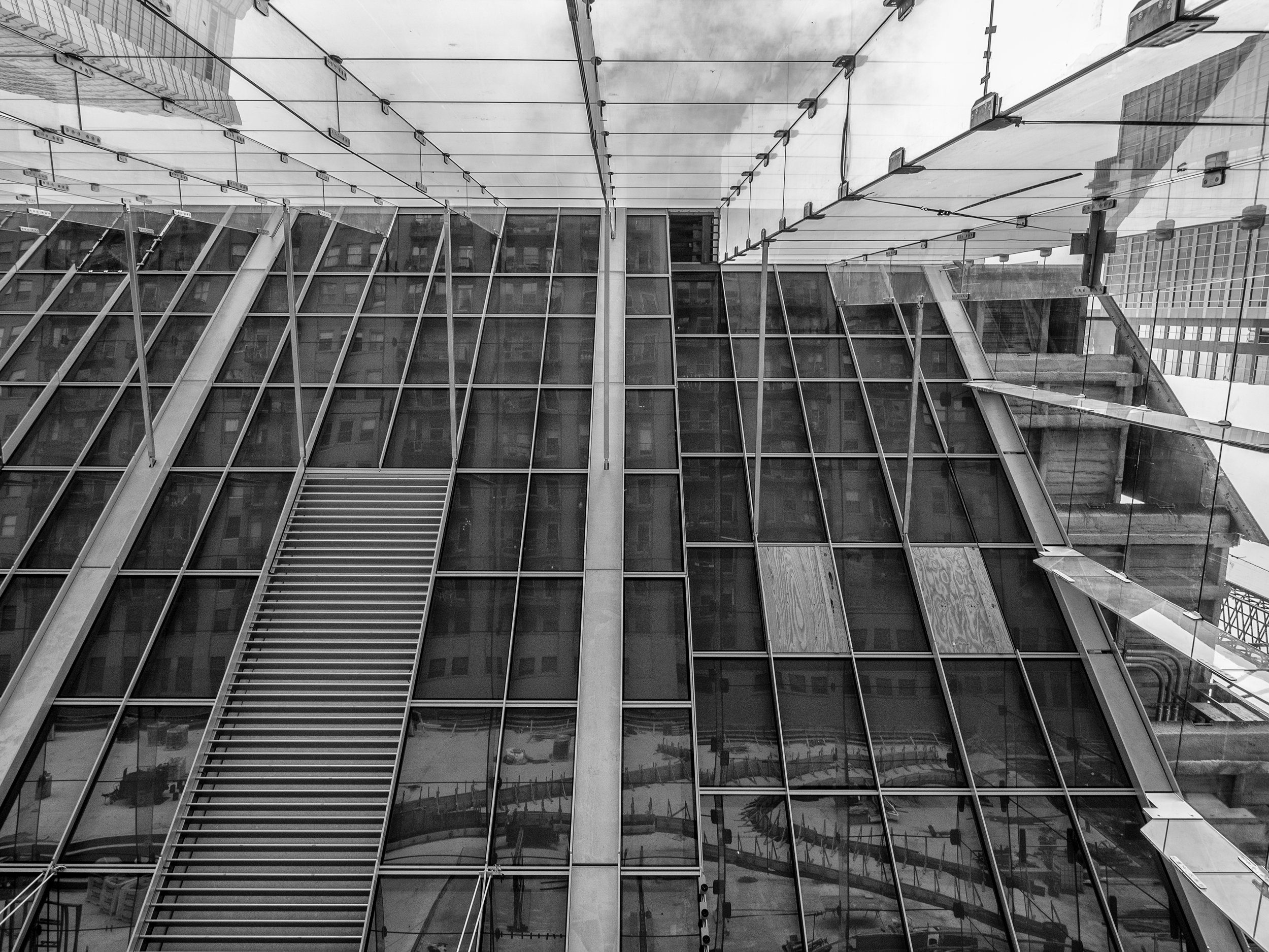 Reflection looking up from the lobby space- can see the landscape reflected from the angled surface