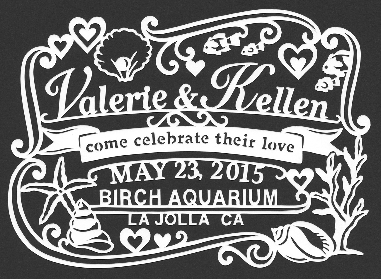 customized papercut wedding invite with shells and hearts