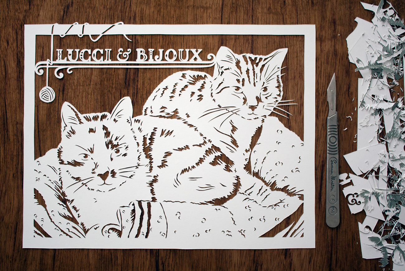 papercut portrait illustration of two tabby cats