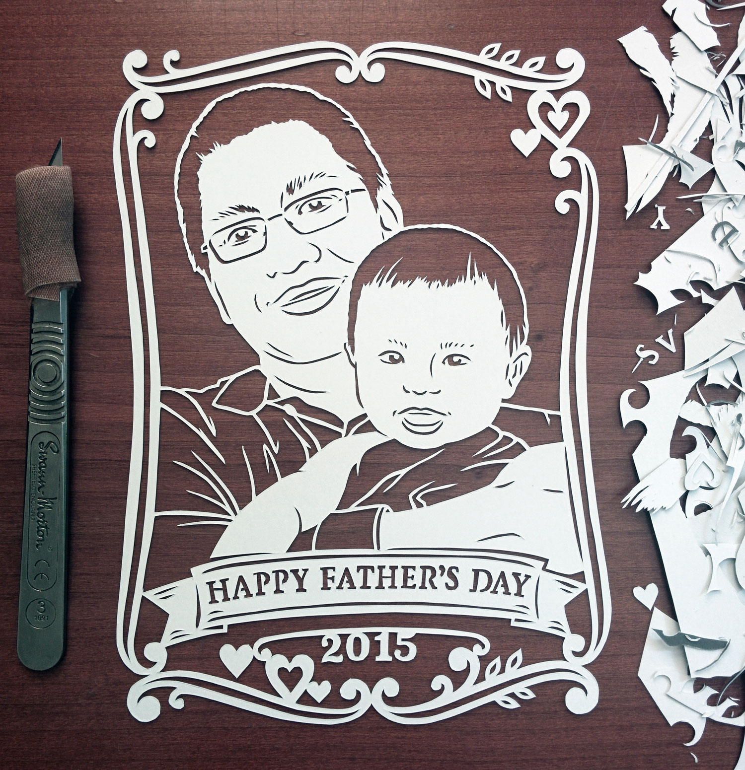 papercut portrait illustration of father and baby son