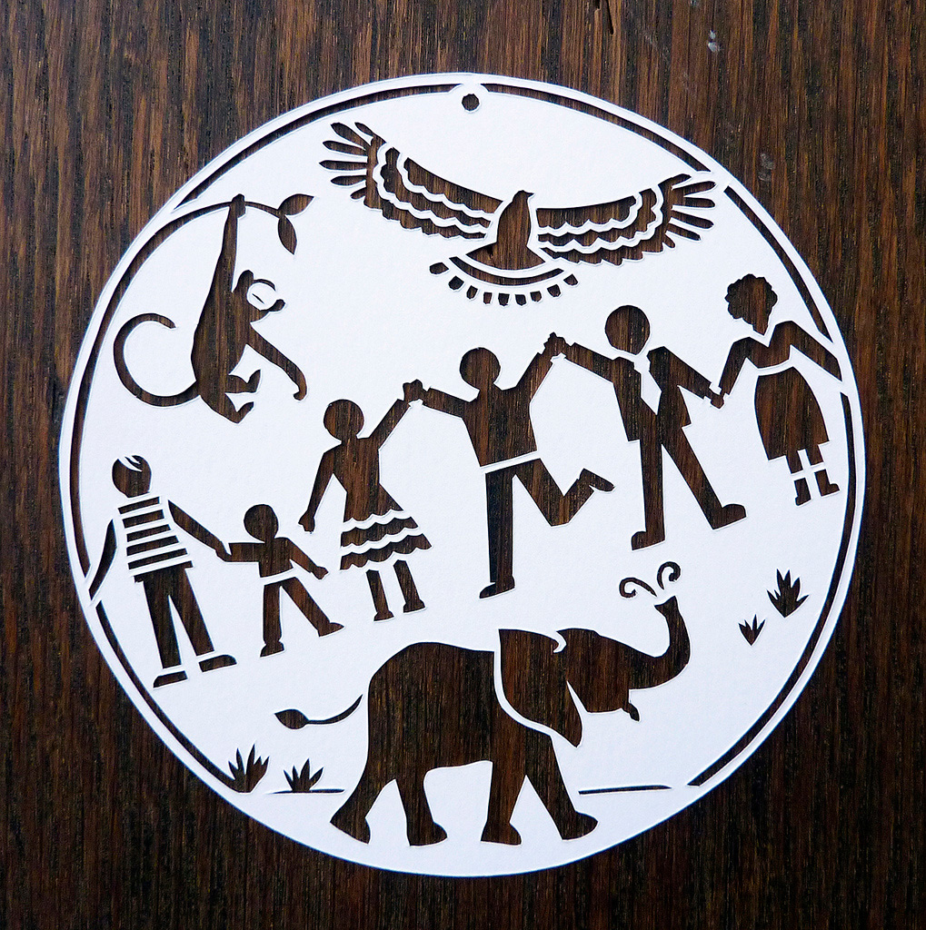 circle papercut illustration with people eagle and elephant