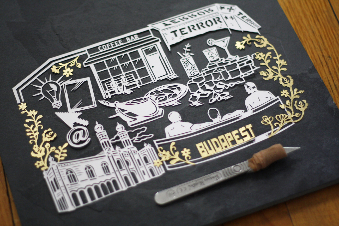 papercut illustration of budapest hungary in gold and white