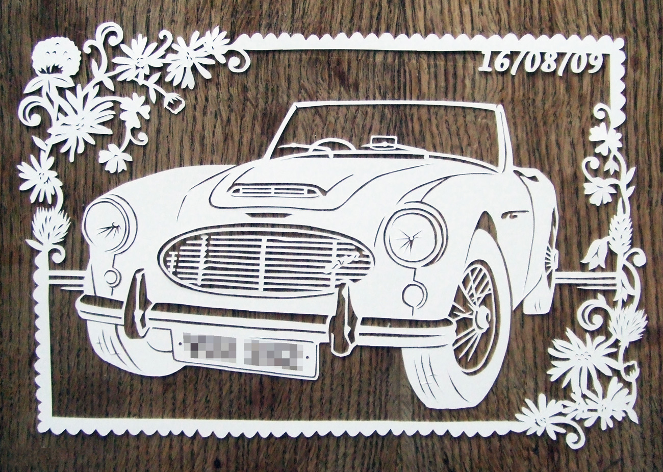 papercut illustration of vintage car and flowers