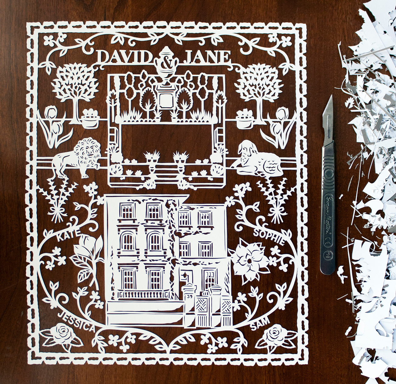 papercut illustration of house and garden with flowers