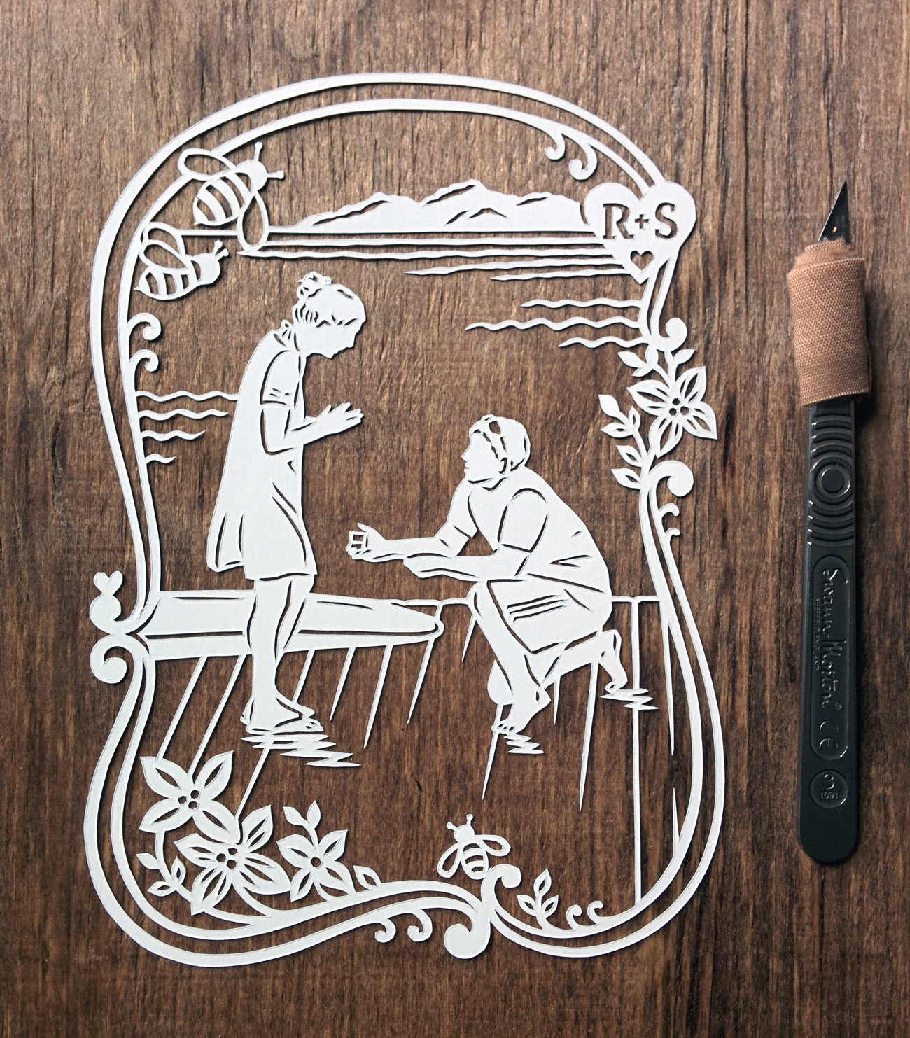 papercut illustration of man proposing to pretty woman