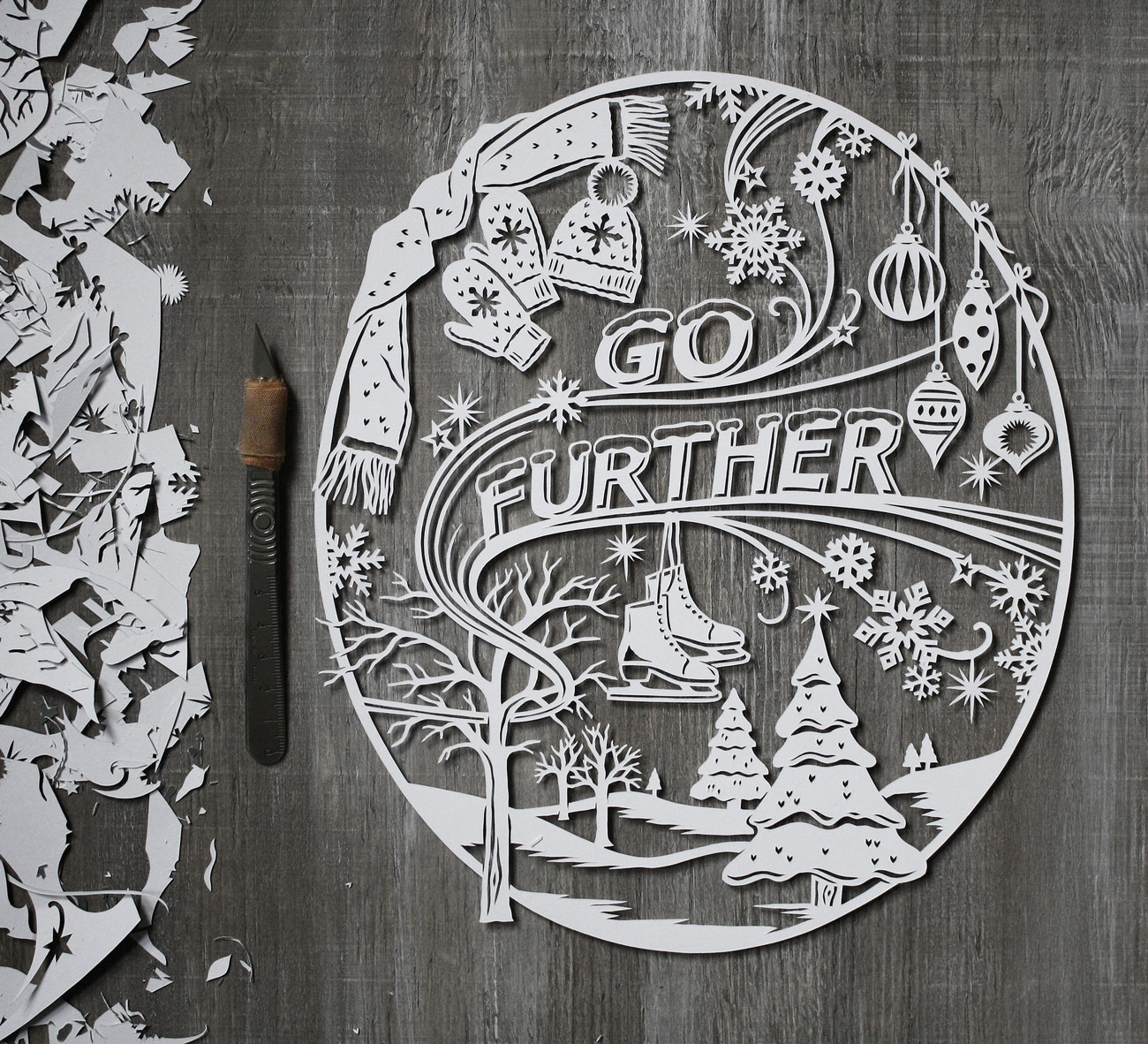 winter papercut illustration for ford with snowflakes and trees