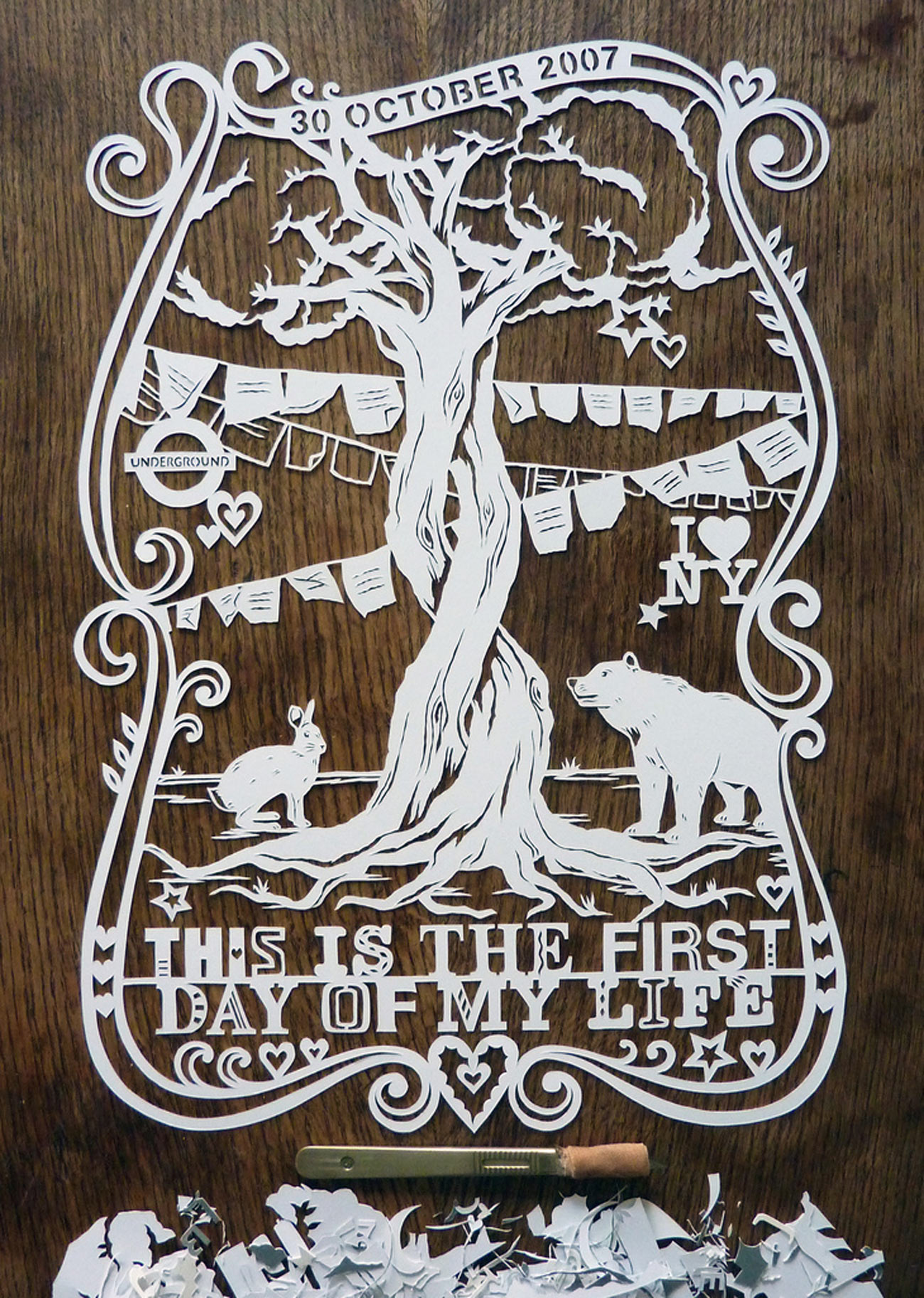 papercut illustration with old tree, rabbit and bear