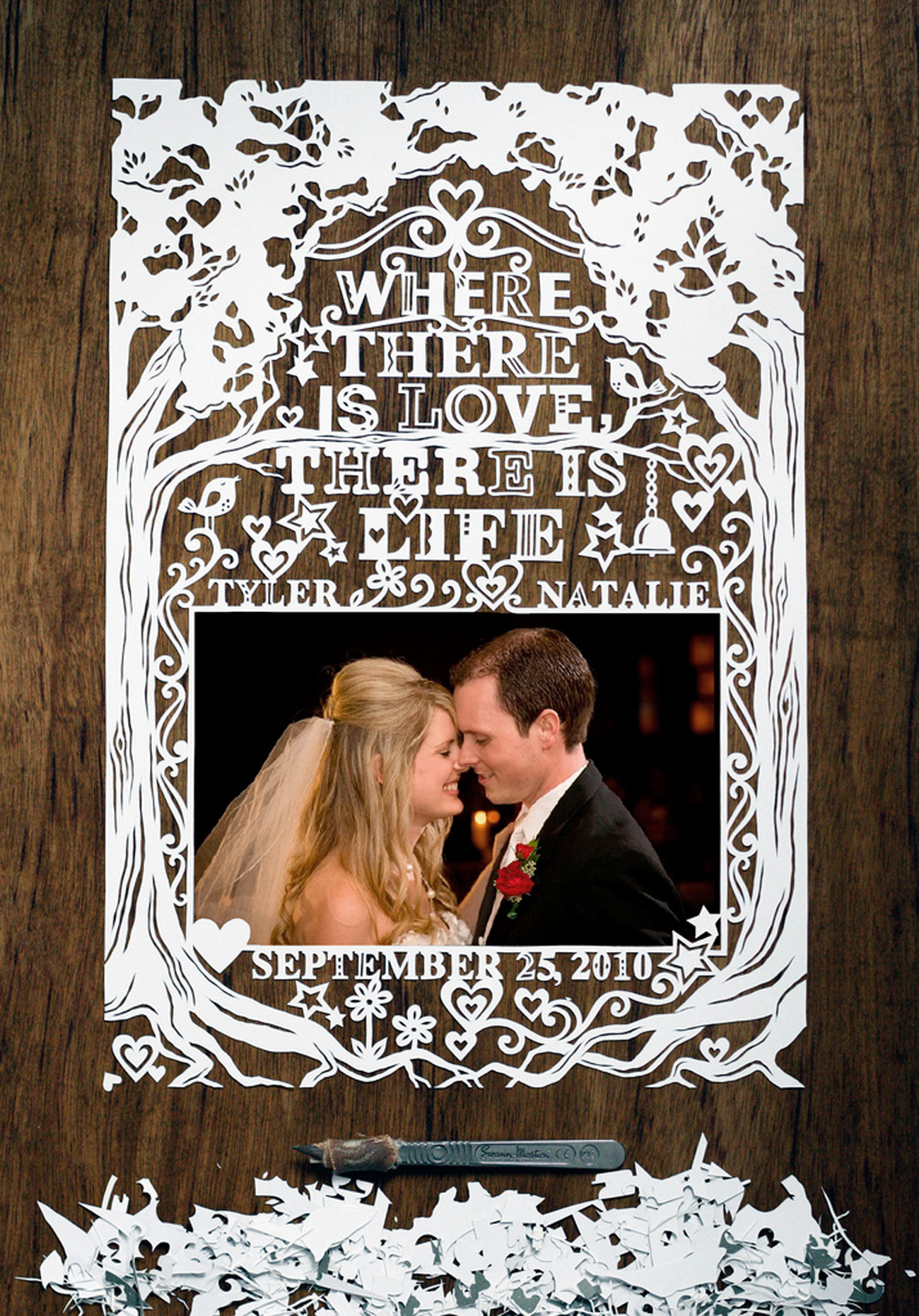 beautiful papercut frame for wedding photo with bride and groom