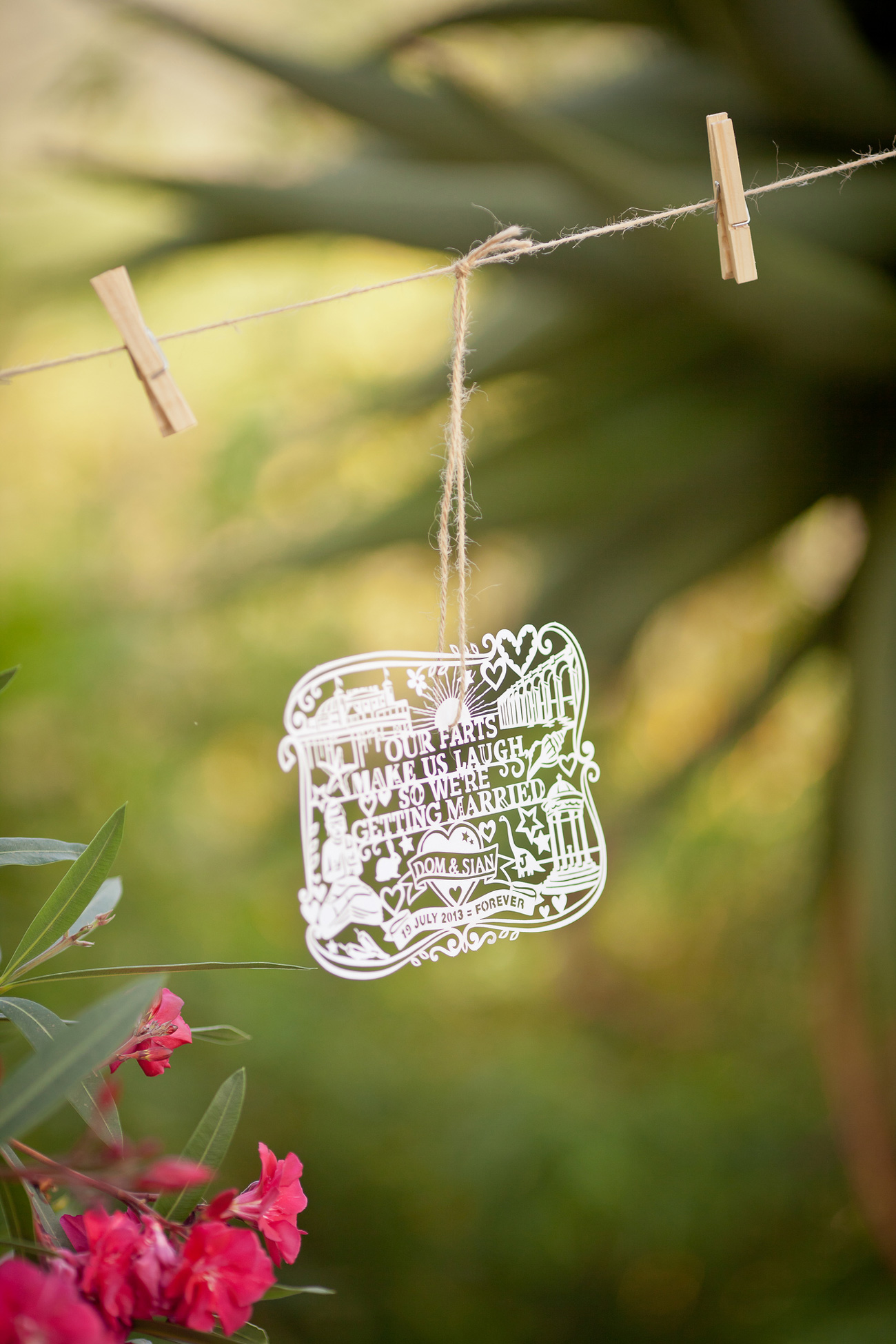papercut wedding invitation in the garden with flowers