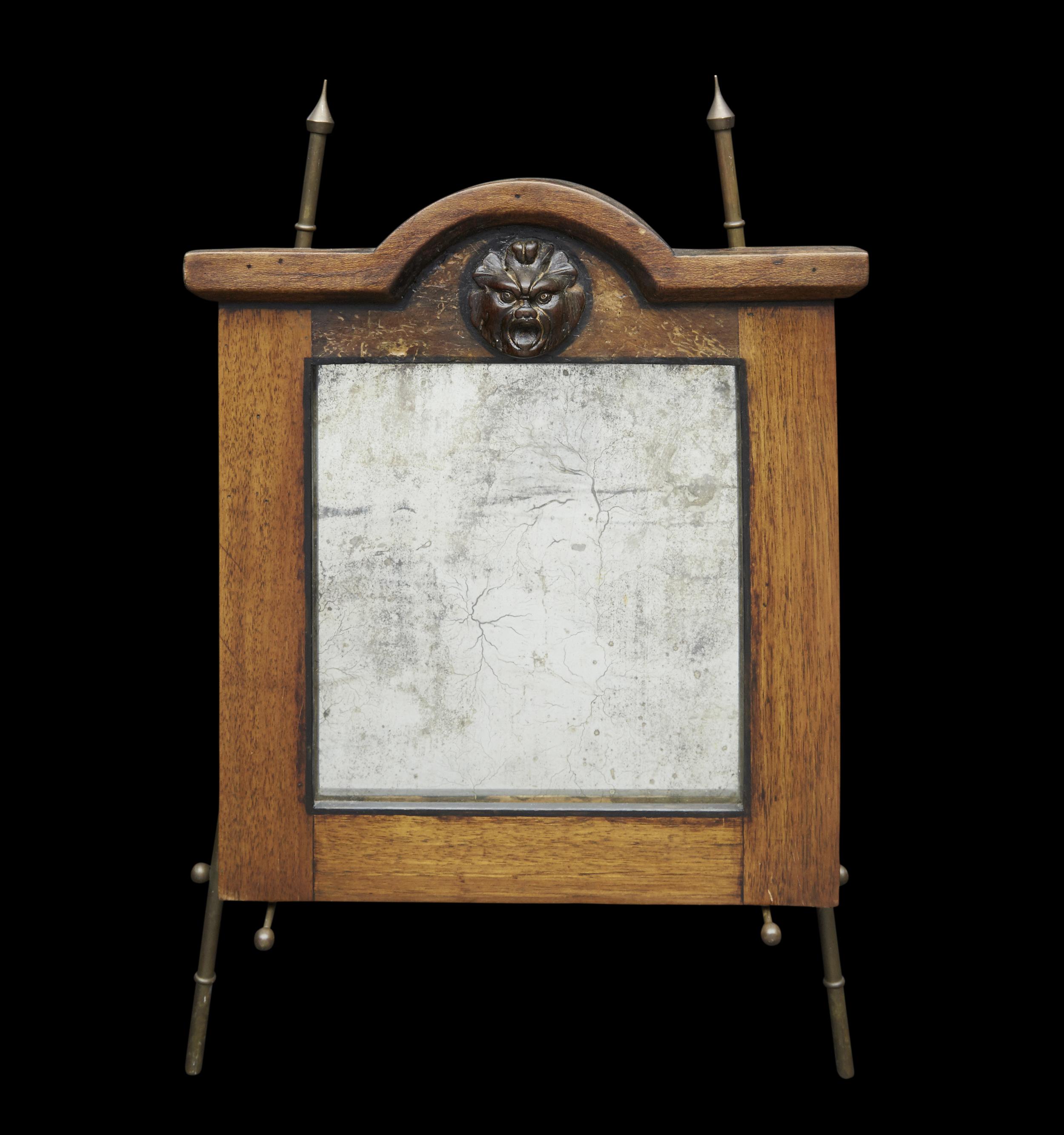 "18th Century oak mirror with mask  13"" h. x 12"" w.  $6,400"