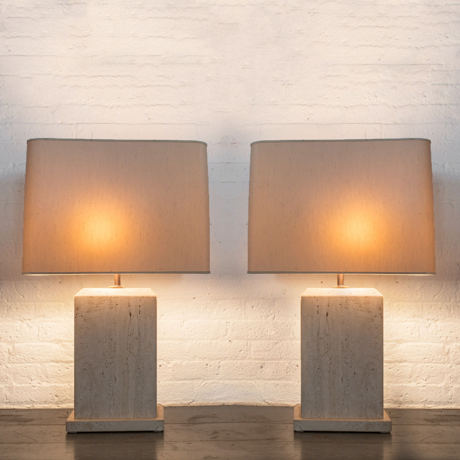 """Pair of Travertine lamps  30"""" h. x 19"""" w. x 9"""" d.  $7,600"""