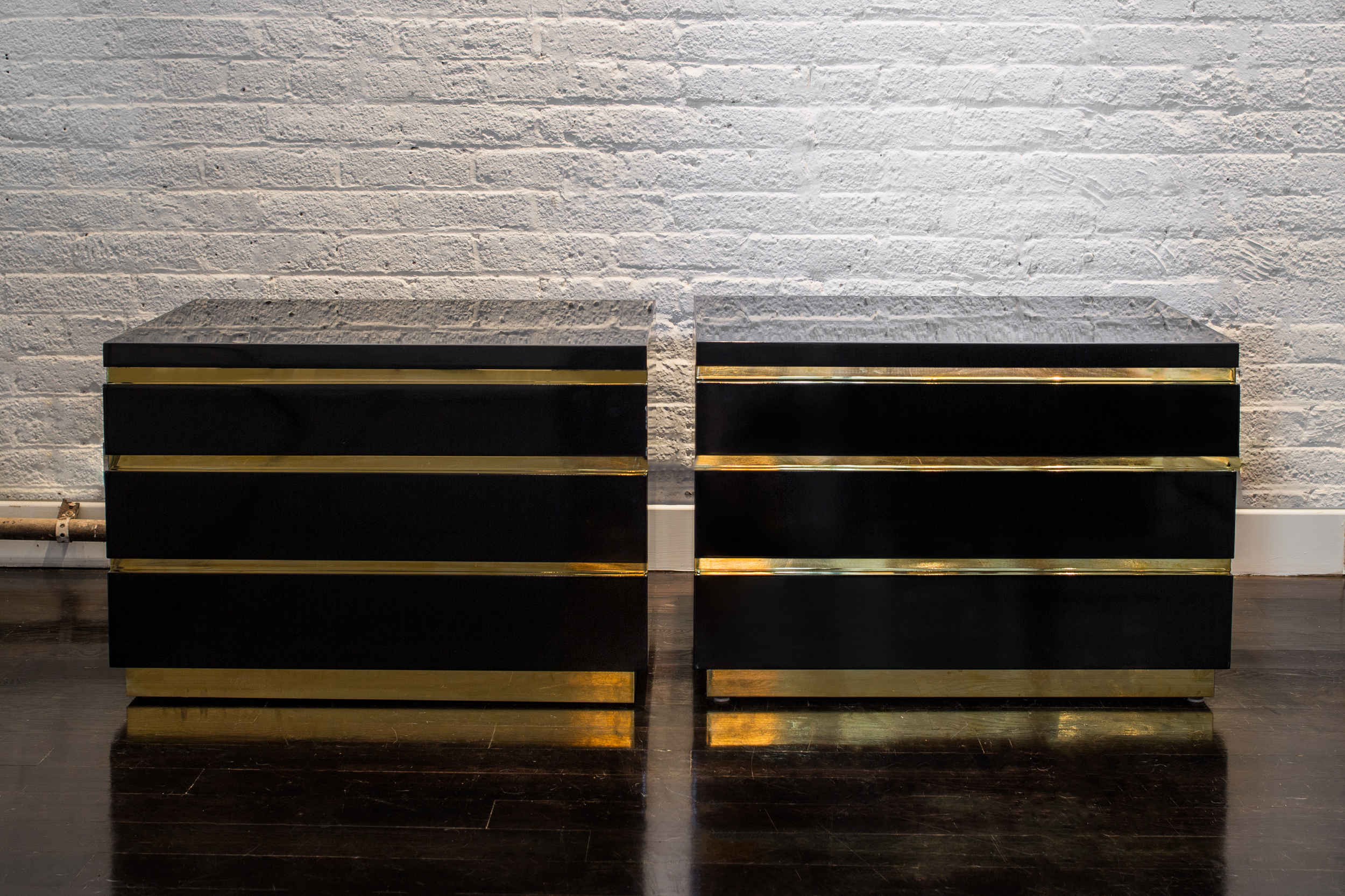 "Pair of Black Lacquer and Brass Chests  26"" w. x 18"" h. x 18"" d.  $8,900"
