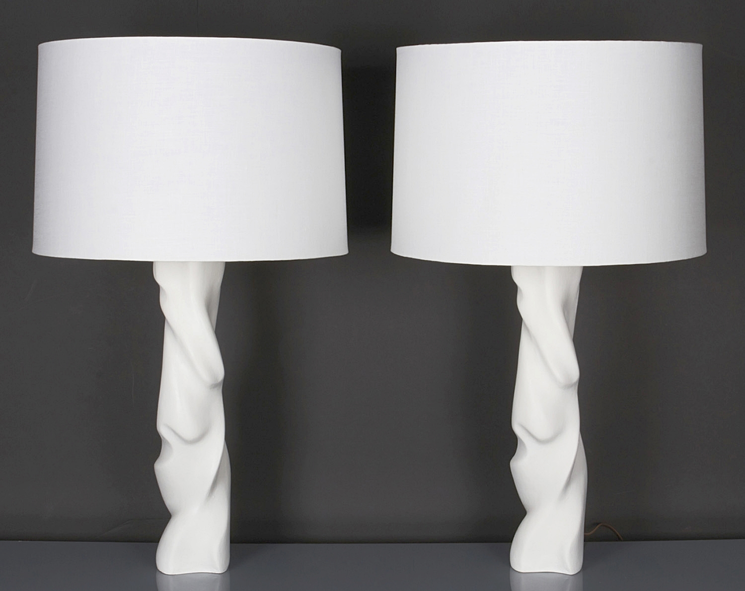 "Pair of Waxed Plaster Lamps  34"" h. x 7"" w.  $7,800"