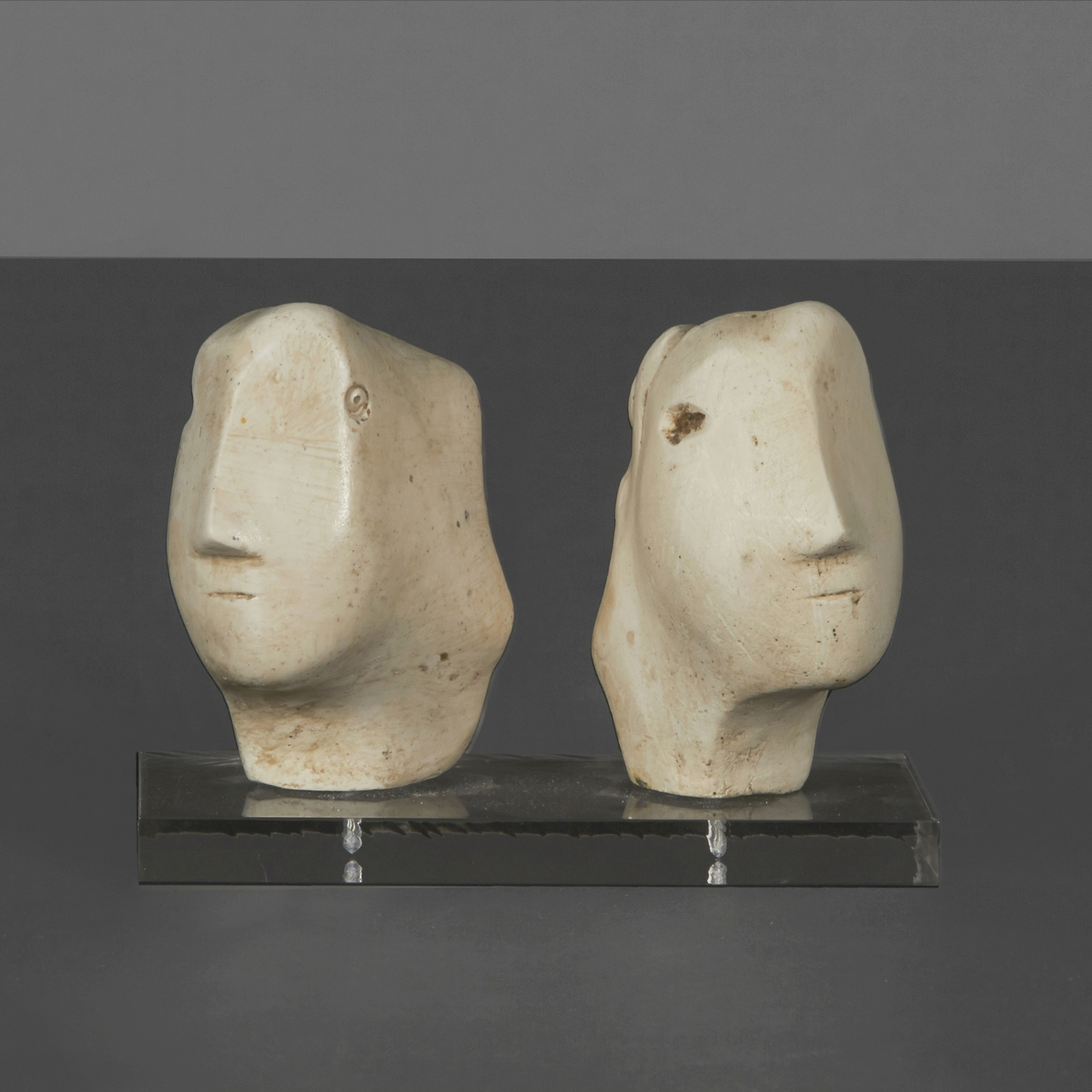 """H. Moore - Two Heads  4"""" h.  $3,600"""