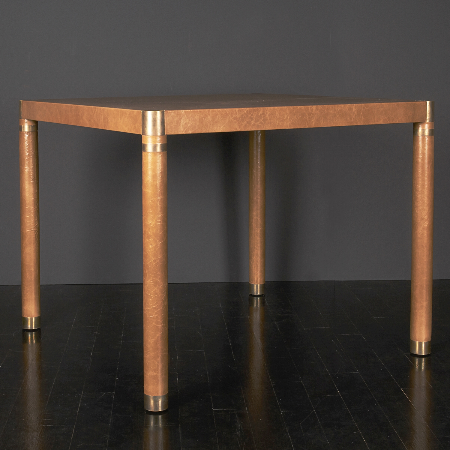 "Leather and Brass Card Table  36"" sq. x 30"" h.  $8,900"