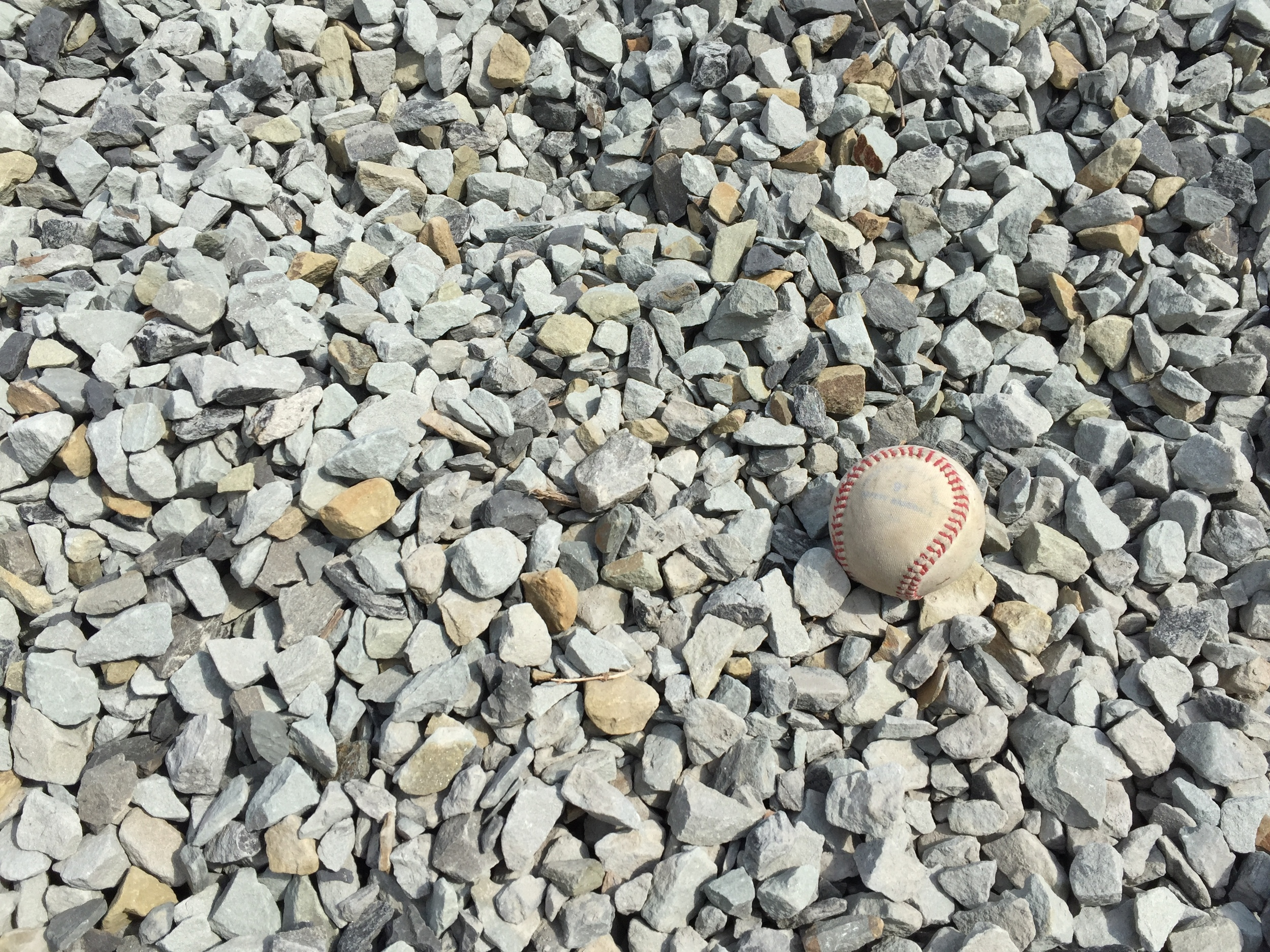 Use this baseball in the picture to gain a perspective on the size of the stone.