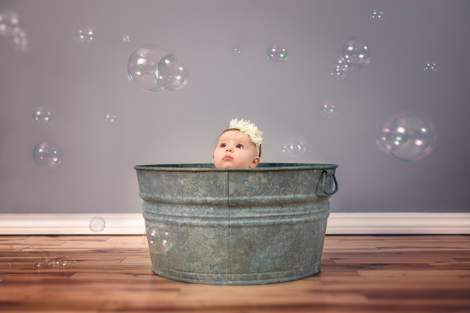 Baby's first bubbles!! Love that curious expression on her little face! - Springfield Missouri family photography