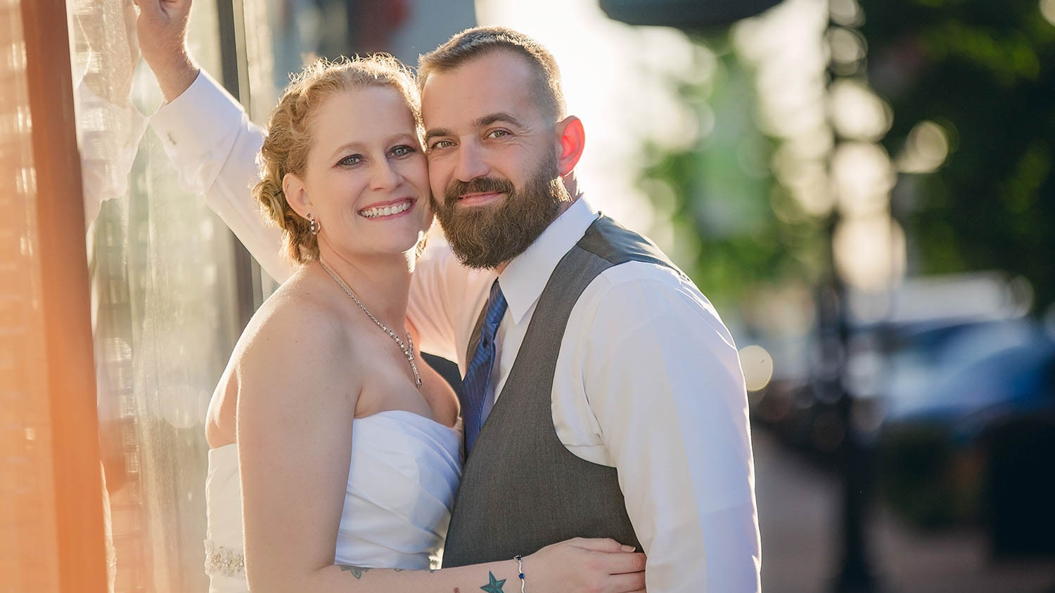 Bride and groom are back lit by the golden sunset on historic Commercial Street outside of the Savoy Ballroom, Springfield Missouri