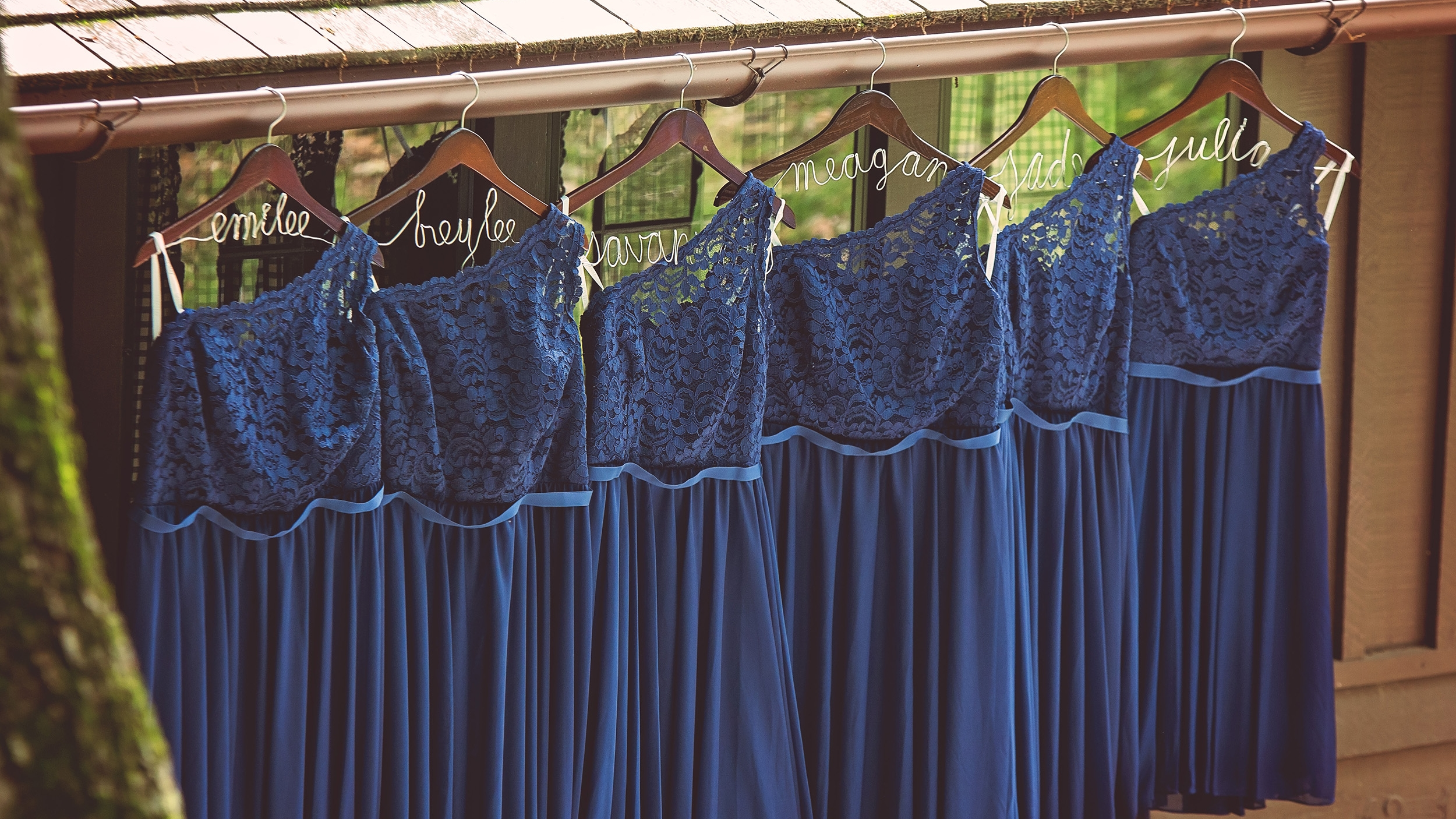 Bridesmaids dresses on personalized hangers