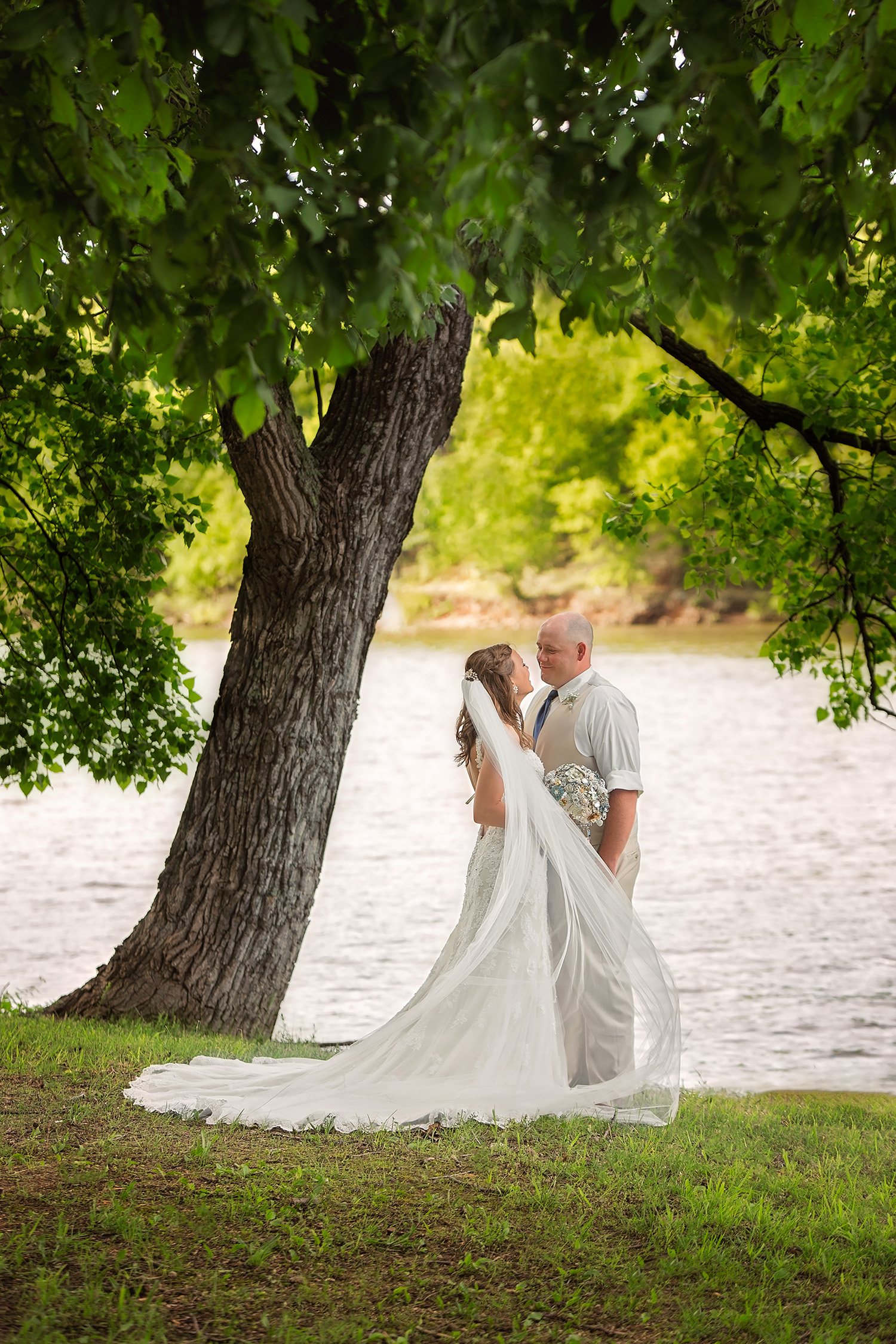Bride and groom enjoy the view by the lake - Springfield, MO wedding photographers