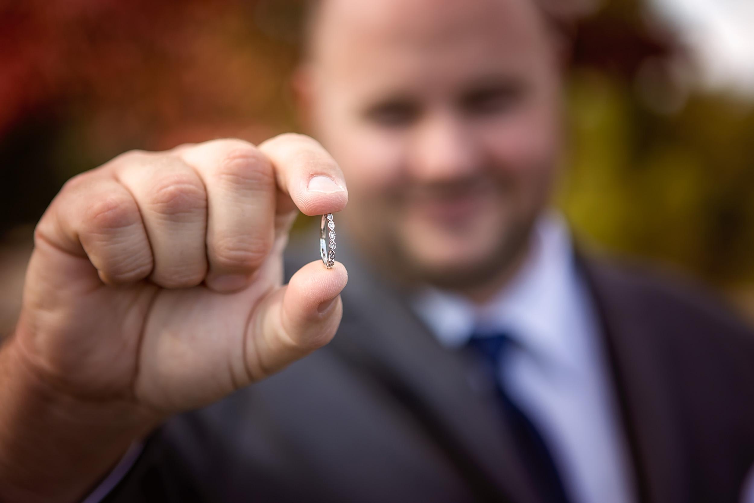 Groomsman shows off wedding ring