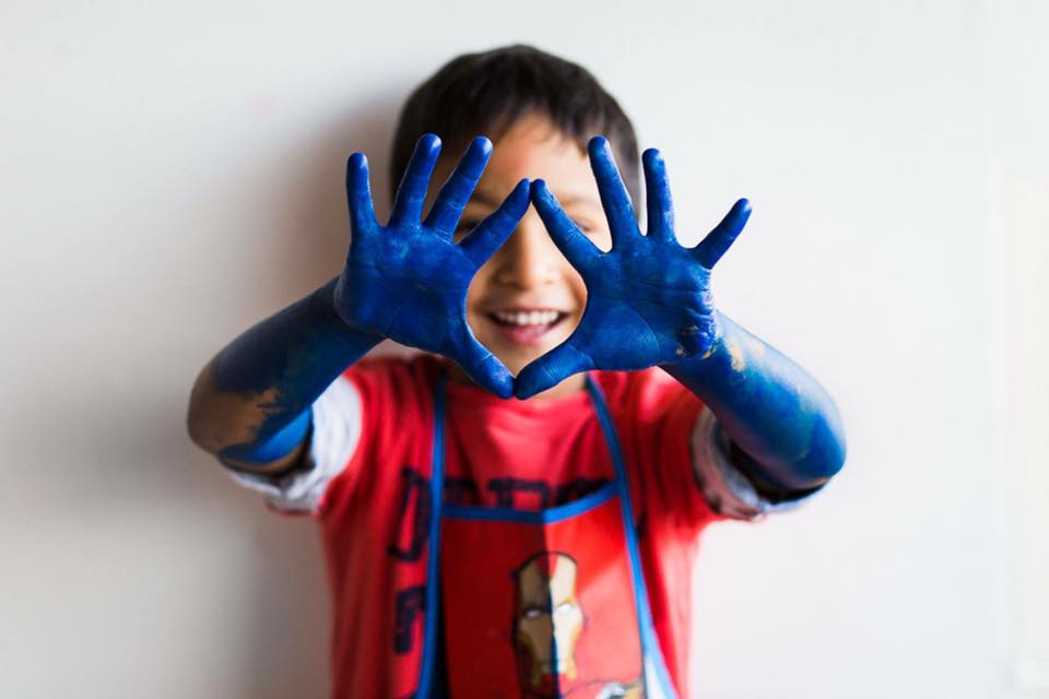 blue hands happy boy family pose photographer workshop candid you photography