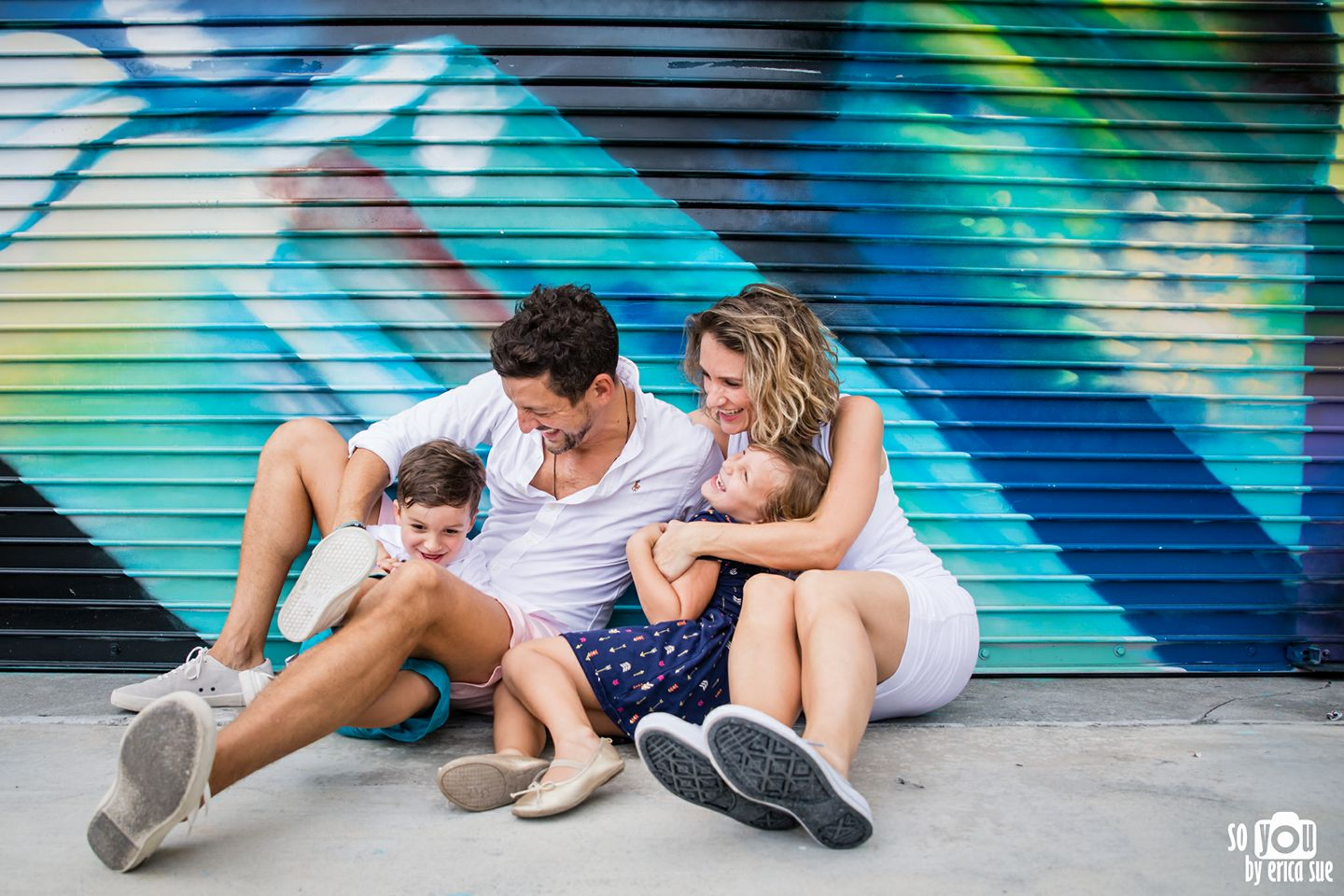 connected emotive family pose photography laughing tickling so you by erica sue