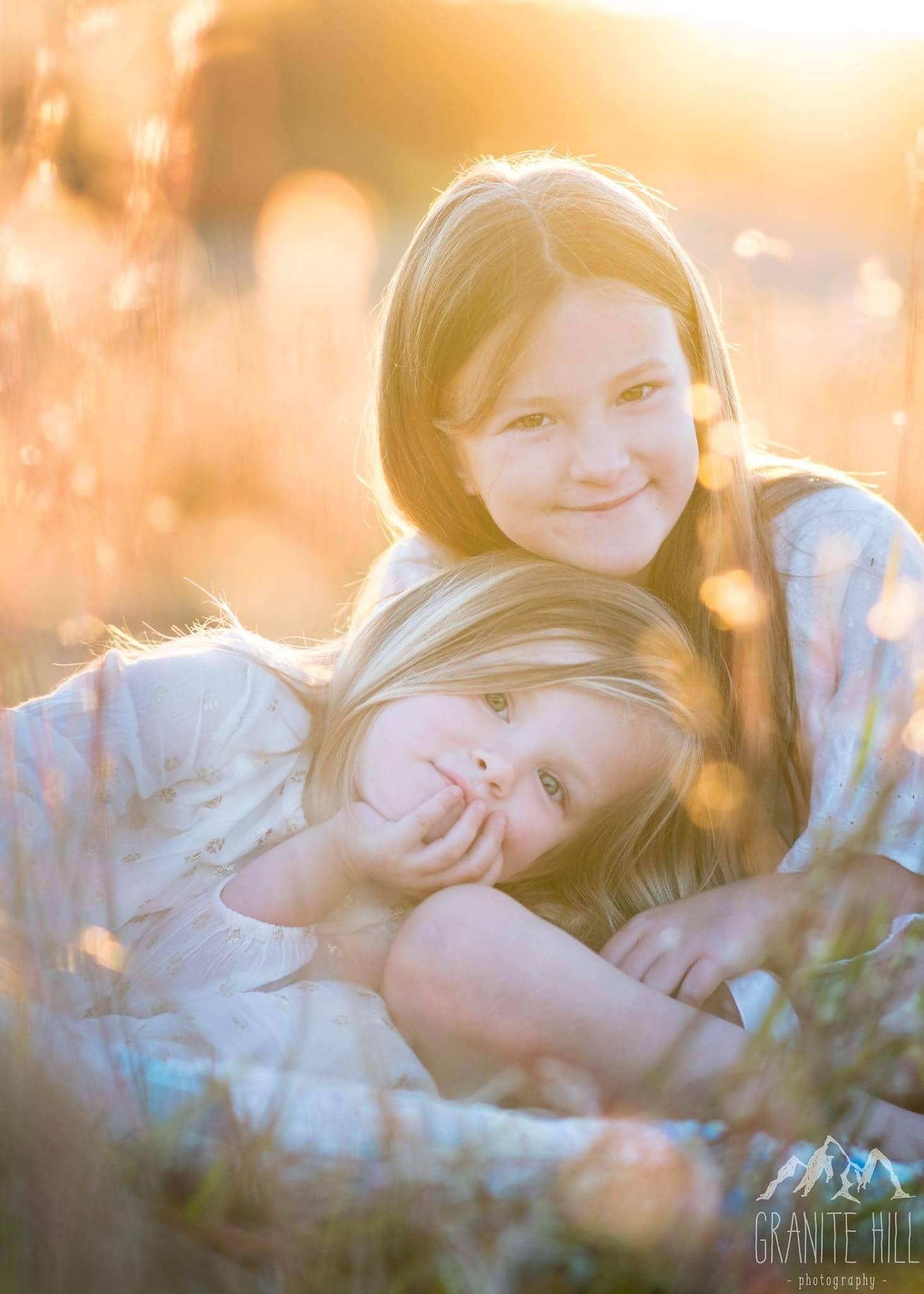 sisters golden light connected posing family photography brigitte reid