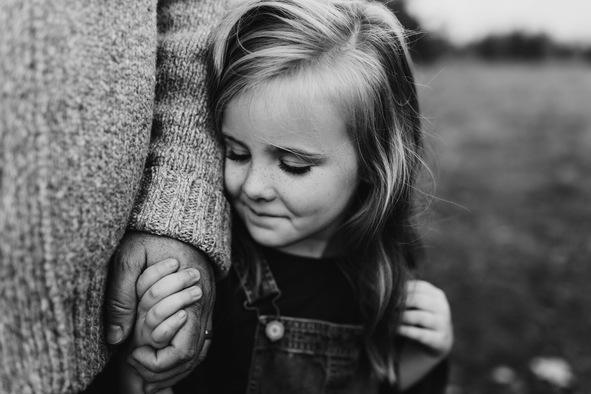 black and white beautiful connected holding hands emotive family posing photography education erin aasland