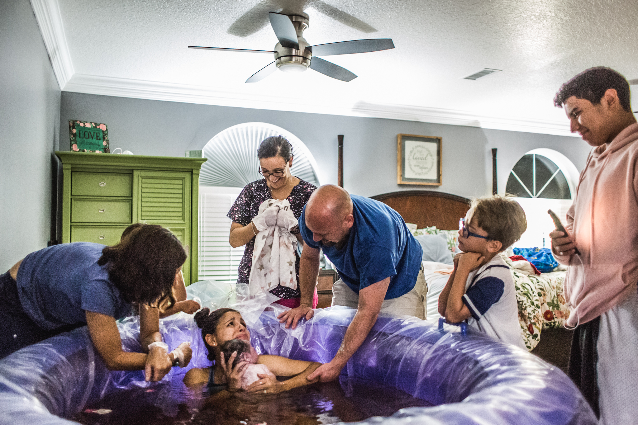 surprise gender reveal after water birth at home with a midwife and children awake  4.jpg
