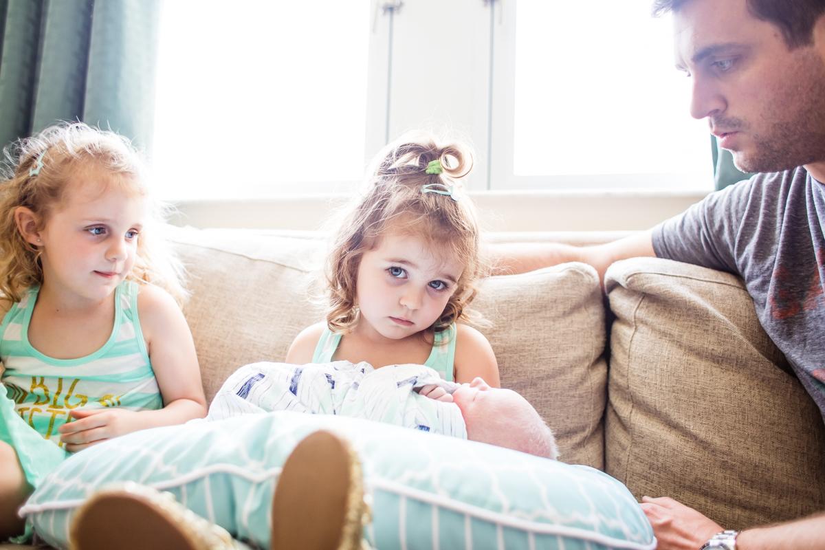 big sister holding baby.jpg