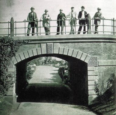 View of Willowdell Arch with the team that created Central Park. Standing on the pathway over the span, from Right: Frederick Law Olmsted, Jacob Wrey Mould, Ignaz Anton Pilat, Calvert Vaux, George E. Waring Jr., and Andrew Haswell Green. Photographed in 1862.