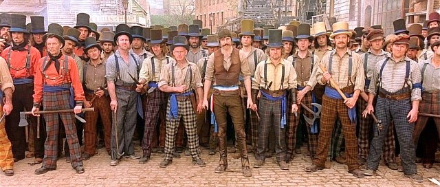 "William ""Bill the Butcher"" Cutting's U.S.-born nativist gang, the Natives – played in ""Gangs of New York"" by Daniel Day-Lewis (center, with handlebar mustache) leads his  Bowery Boys  into battle in Paradise Square. The square was meticulously recreated for the film  Gangs of New York.   Image: courtesy of Miramax"