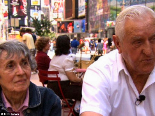 Memories: George Mendonsa and Greta Zimmer Friedman reunited in Times Square, the location of their famous kiss, to reflect on the inspiring photograph that came to symbolize the end of the war (Photo: CBS News)